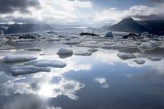 Fjallsarlon glacier lake. Iceberg and sky reflection in Fjallsarlon glacier lake. Iceland Stock Photography