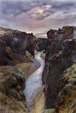 Fjaðrárgljúfur canyon with river and clouds, Iceland. Fjaorargljufur Fjaðrárgljúfur canyon with river and clouds at sunset, Iceland Royalty Free Stock Photography