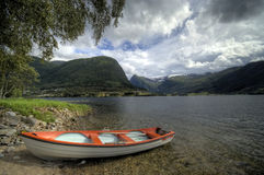 Fjord boat under tree Royalty Free Stock Photography