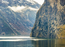 Fjord Cliffs and Fog, Norway Stock Photos
