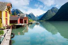Fjord with colorful houses and mountains in Norway Royalty Free Stock Photography