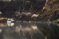Fjord and a cruise liner Royalty Free Stock Photography