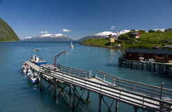 Fjord and fishing boat pier Royalty Free Stock Photography