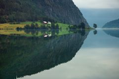 Fjord in Norway. Morning reflection royalty free stock image