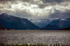 Fjord in Norway in the summer in cloudy weather, in the backgrou Royalty Free Stock Image