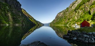 Fjord in Norway with red house royalty free stock image