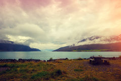 Fjord in rainy weather. With cloudy sky royalty free stock image