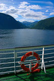 Fjord seen from boat deck. The Geiranger fjord is one of Norway's most visited tourist sites and has been listed as a UNESCO World Heritage Site Royalty Free Stock Photography