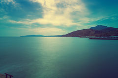 Fjord shore in evening. View of the coast in the light of the evening sun Stock Image