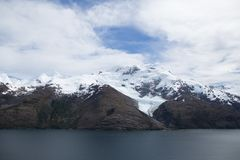 Fjord with snow-covered peaks royalty free stock photography