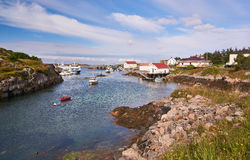 Fjord surrounded by buildings, boats moored Stock Image