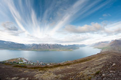 Fjord surrounded by mountains Royalty Free Stock Images
