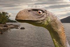 Fjorden Ness Monster eller nessien är en varelse sade att bebo Loch Ness i den skotska Skotska högländerna royaltyfri foto