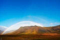 fjordsiceland norr over regnbåge Arkivbild
