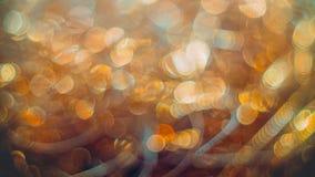 Flámulas de oro con el brillo chispeante - hackground de los días de fiesta de la Navidad Foto de archivo