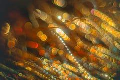 Flâmulas douradas com brilho efervescente - fundo dos feriados do Natal Imagens de Stock