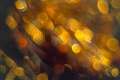 Flâmulas douradas com brilho efervescente - fundo dos feriados do Natal Foto de Stock