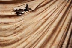 Fläck på den gamla bruna torkduken för bakgrund Royaltyfria Bilder