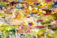 Fläckar för grön guld för vattenfärgen formar pastellfärgade gula röda, kontrast bakgrund i pastellfärgade toner fotografering för bildbyråer
