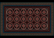 Fläckig orientalisk matta med den original- modellen på en svart bakgrund Arkivbild