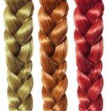 Fläta hår, tre isolerade färgade flätor, håromsorg Royaltyfria Foton