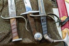 Fläta sabeln och svärd royaltyfria bilder