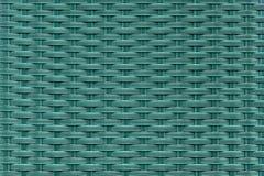 Fläta samman plast- fibrer i turkosfärg Designtextur Arkivbild