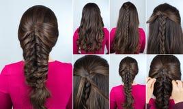 Flätad tråd för frisyr på orubbligt lockigt hår royaltyfri fotografi
