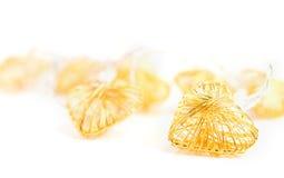 Flätade guld- dekorativa hjärtor Royaltyfri Fotografi