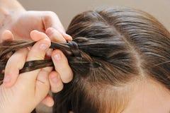 Flätade trådar för frisyr arkivfoto