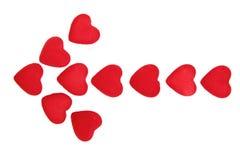 Flèche des coeurs rouges Photo stock