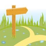 Flèche en bois sur la route Photographie stock