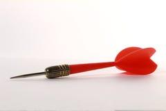 flèche en plastique rouge de dard avec le fond blanc Photos libres de droits