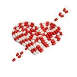 Flèche sur la capsule de coeur Photo stock