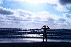 Fléchissement à la plage photo libre de droits