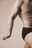 Fléchissement de son muscle Photographie stock