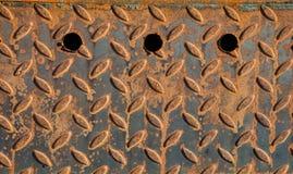 Flöjtlikt rostigt järn Arkivfoto