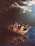Flüchtlinge auf einem Boot mitten in dem stürmischen Meer Stockfotos
