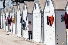 Flüchtlinge, die in den Zelten in der Mittelverlegung Diavata leben Lizenzfreies Stockbild