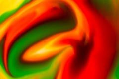 Flüssige Farbe des abstrakten Hintergrundes durch Milch Stockfotografie