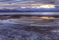 flödande tidvattens- vatten för solnedgång Fotografering för Bildbyråer