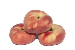 Flache Pfirsiche auf einem weißen Hintergrund Lizenzfreie Stockbilder