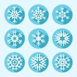 Flache Schneeflocken-Ikonen Stockfoto