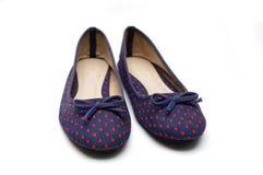 Flache Schuhe der Frauen lokalisiert Stockfotografie
