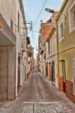 Flache Straße in Calella morgens Stockbild