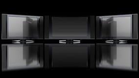 Flacher Bildschirm Fernsehapparat gegen Schwarzes Lizenzfreie Stockfotos