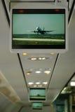 Flacher Bildschirm mit aeorplane auf ihm. Lizenzfreie Stockfotos