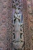 Flachreliefs auf der Wand des alten Tempels lizenzfreie stockfotografie