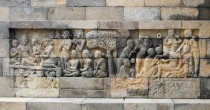 Flachreliefskulpturen in Borobudur Stockbild