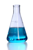 Flacon avec le liquide bleu Image stock